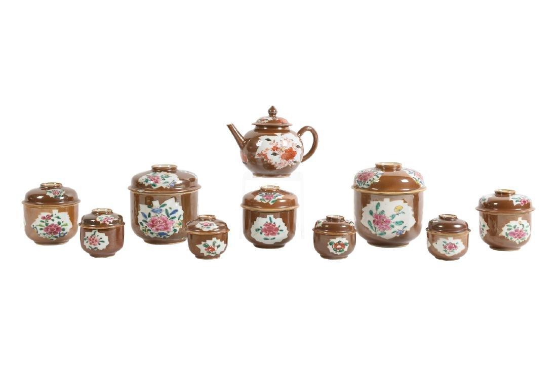 A Capucine porcelain service including nine lidded pots