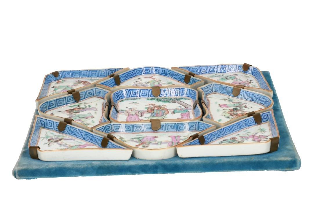 A nine-piece polychrome porcelain condiment set,