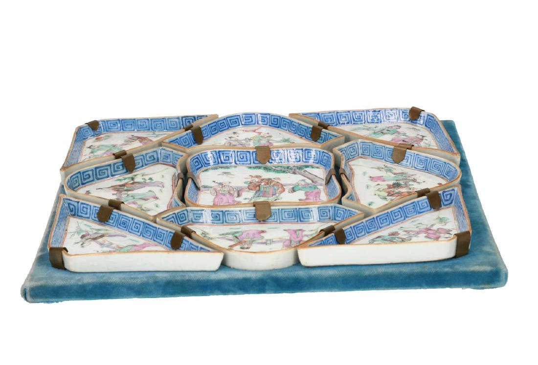 A nine-piece polychrome porcelain condiment set,