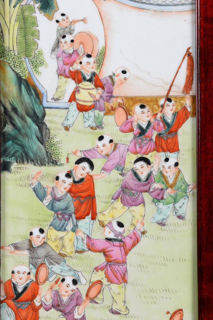 A polychrome porcelain plaque depicting little boys