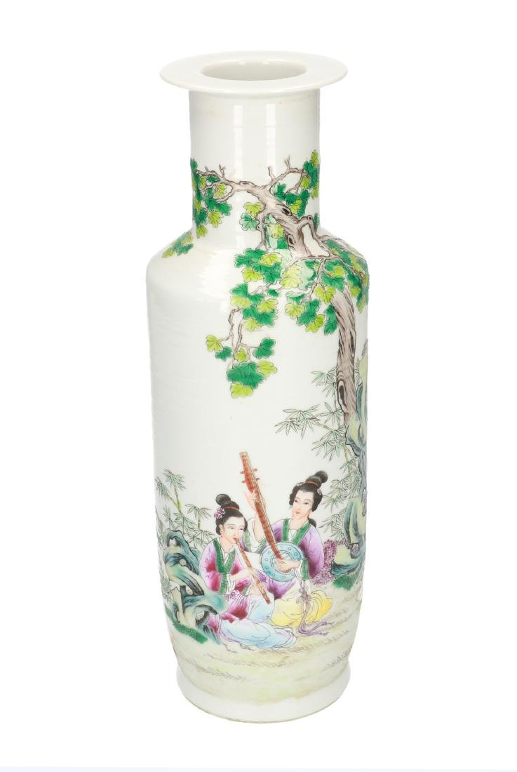 A polychrome porcelain vase, decorated with ladies
