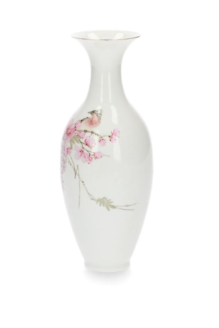 A polychrome eggshell porcelain vase decorated with