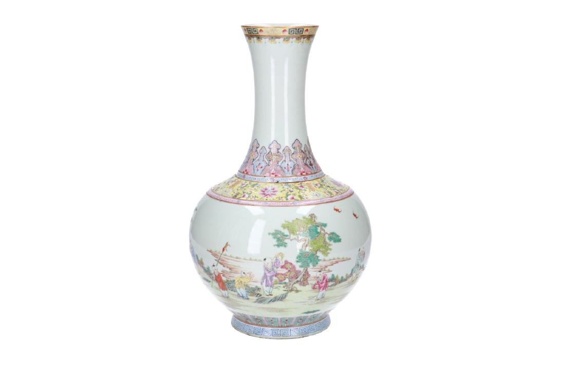 A polychrome porcelain vase, decorated with playing