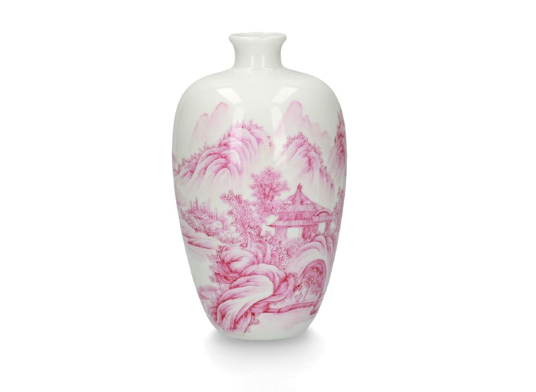 A pink and white porcelain vase with decor of a
