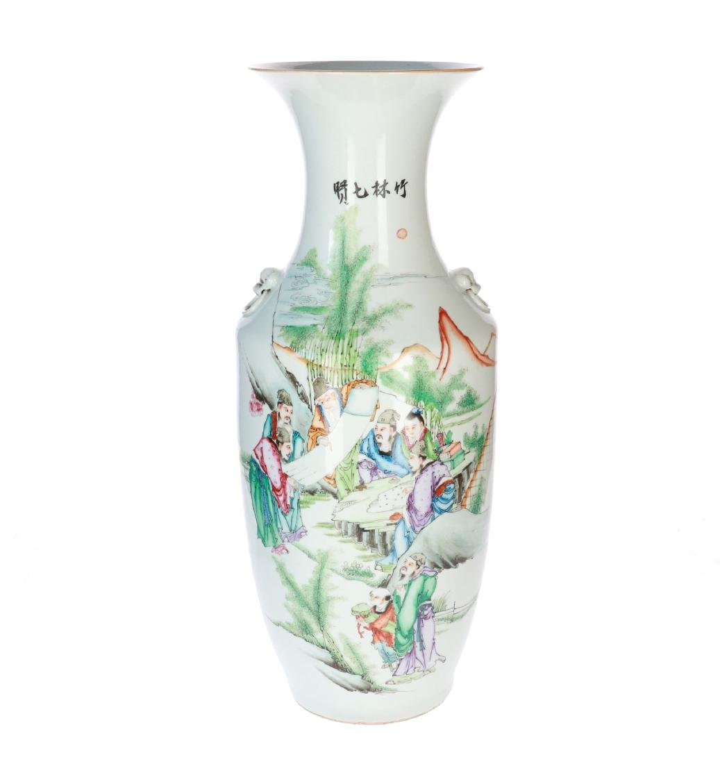 A polychrome porcelain vase decorated with scholars and