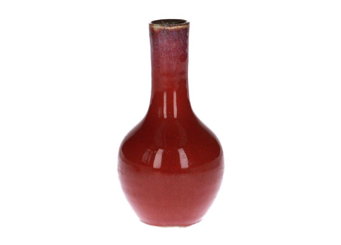 A porcelain flambé vase. Unmarked. China, 19th