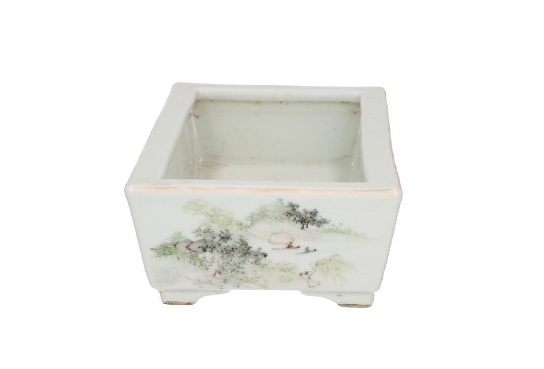 A polychrome porcelain jardinière, decorated with a