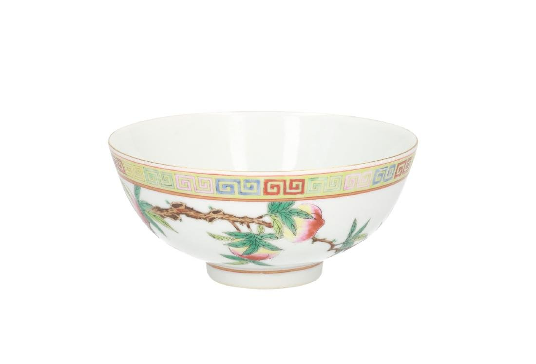 A polychrome porcelain bowl, decorated with peaches.