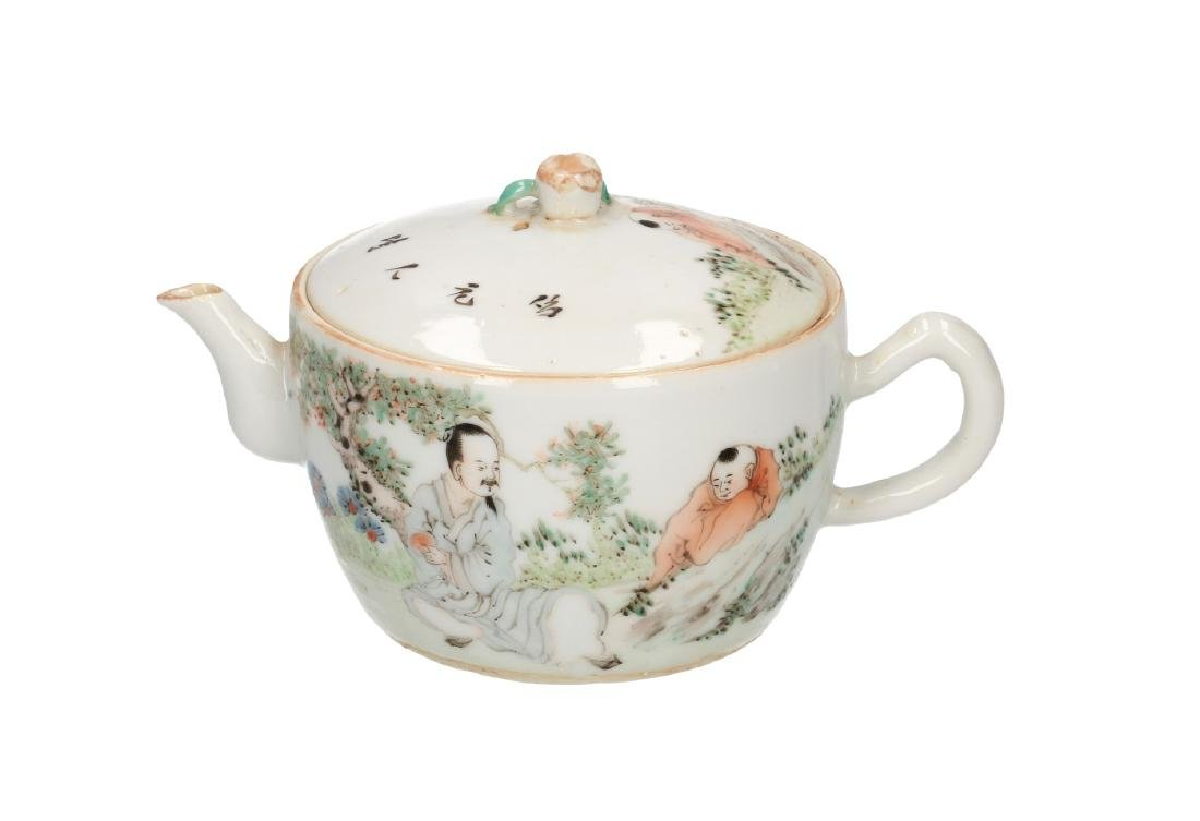 A polychrome porcelain teapot, decorated with figures