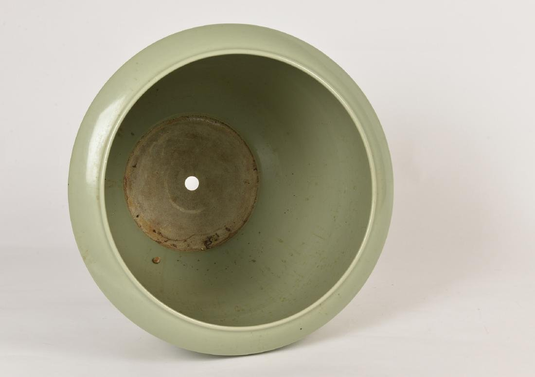 A large celadon porcelain cachepot with white relief - 2