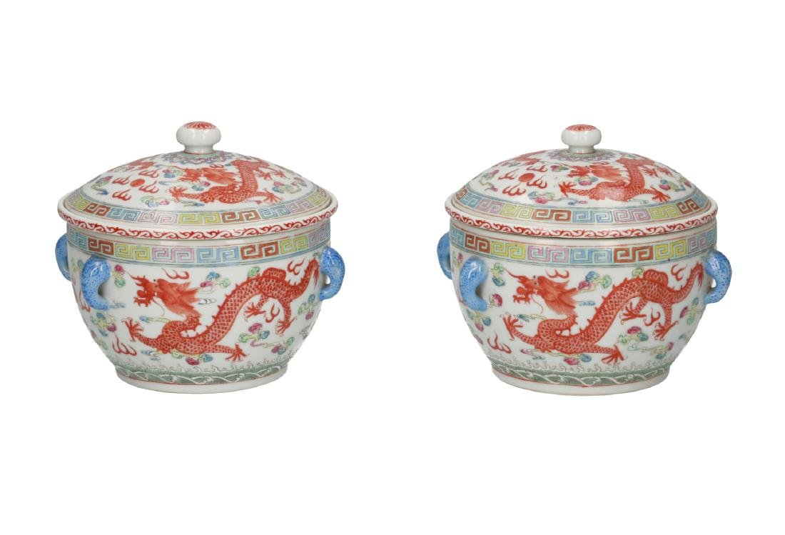 A pair of polychrome porcelain lidded bowls with inner
