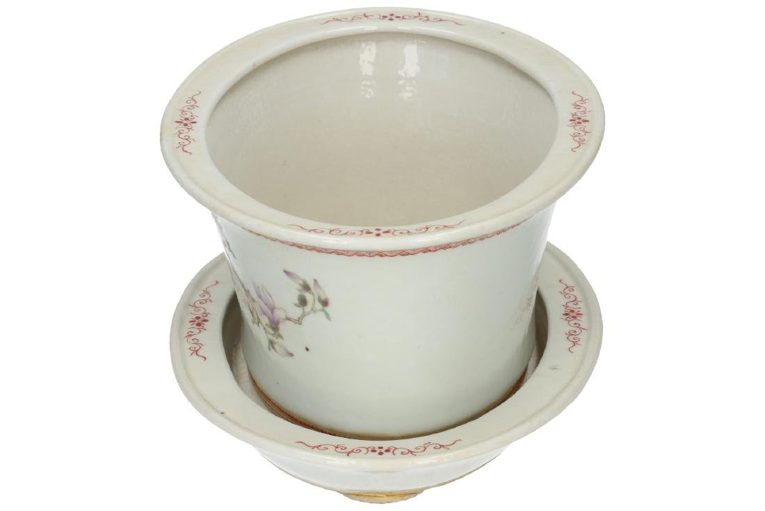 A white porcelain jardinière with charger, with red