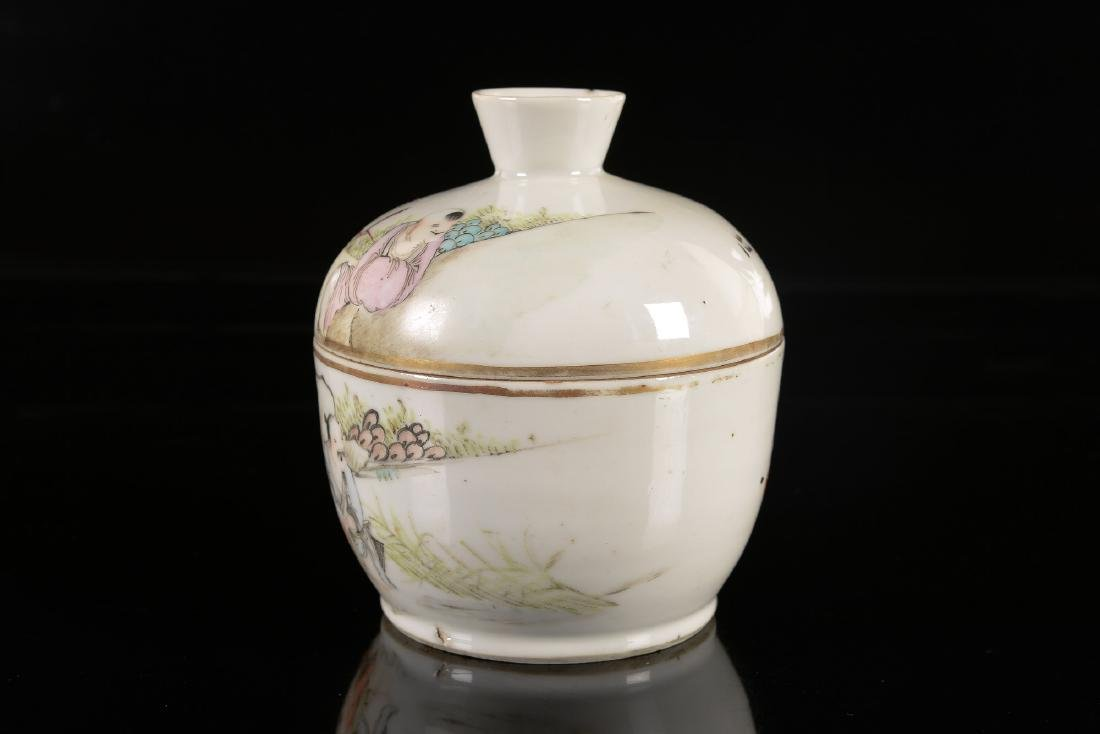 A polychrome porcelain lidded jar decorated with