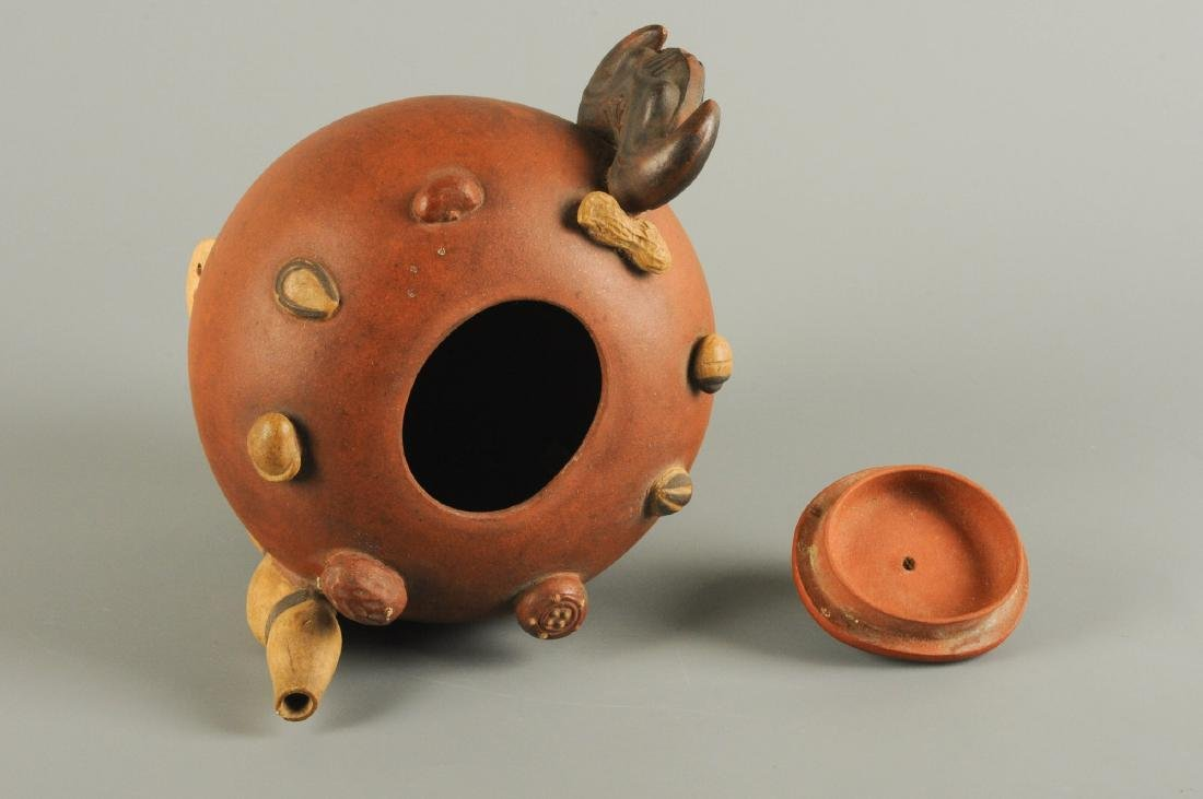 A Yixing teapot, decorated in relief with peanuts and - 2