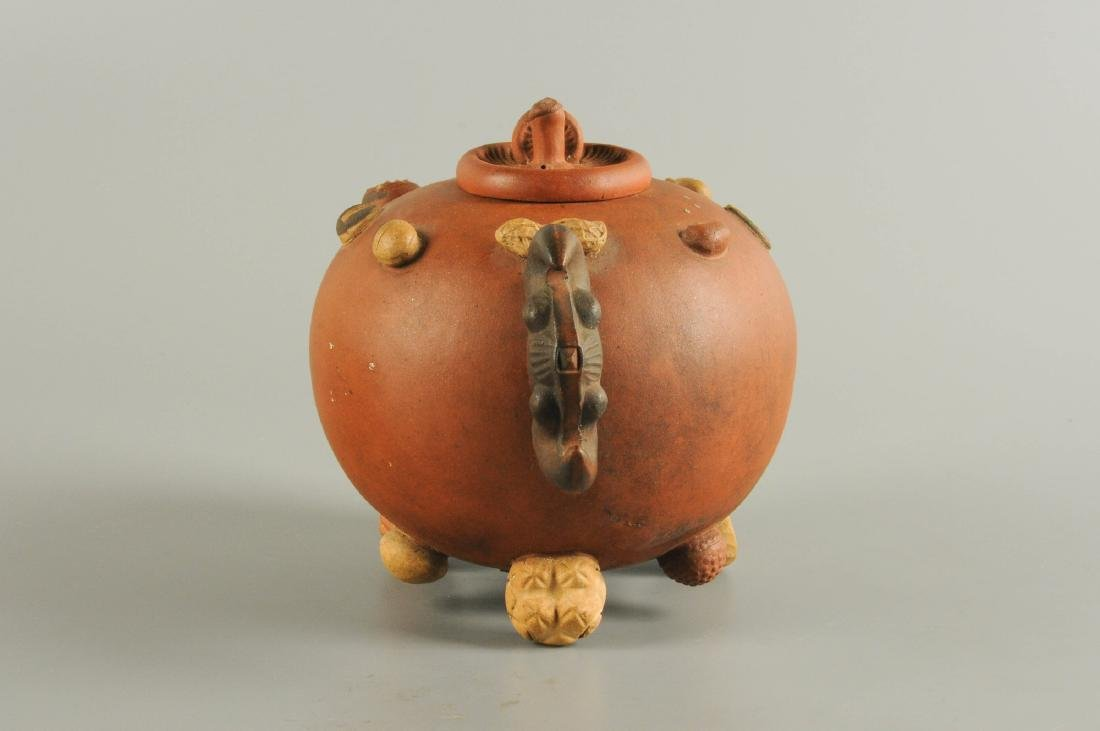 A Yixing teapot, decorated in relief with peanuts and - 4