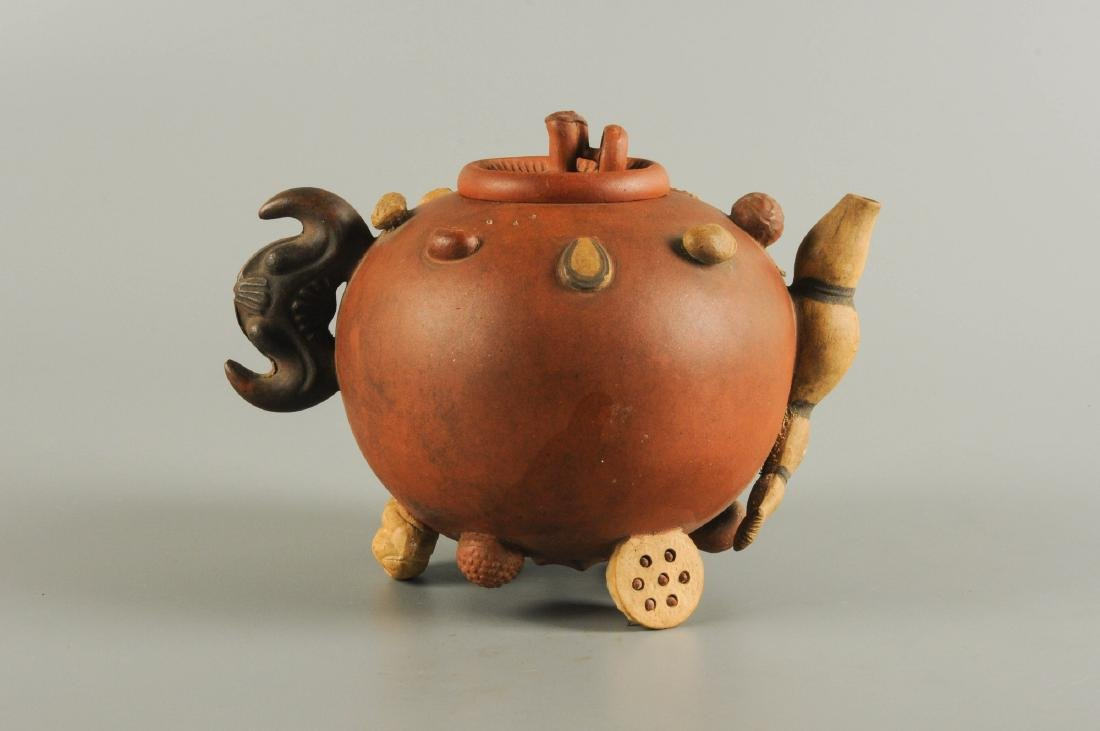 A Yixing teapot, decorated in relief with peanuts and - 5
