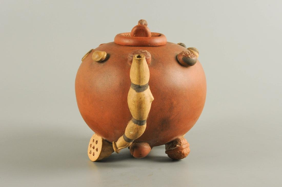 A Yixing teapot, decorated in relief with peanuts and - 6