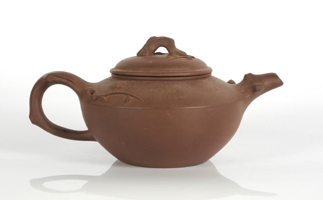 A Yixing teapot with a decor of branches and