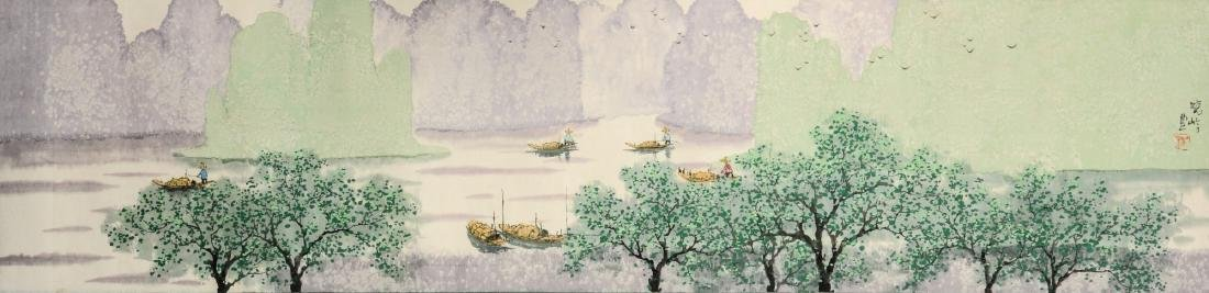 A scroll depicting a river landscape with boats.