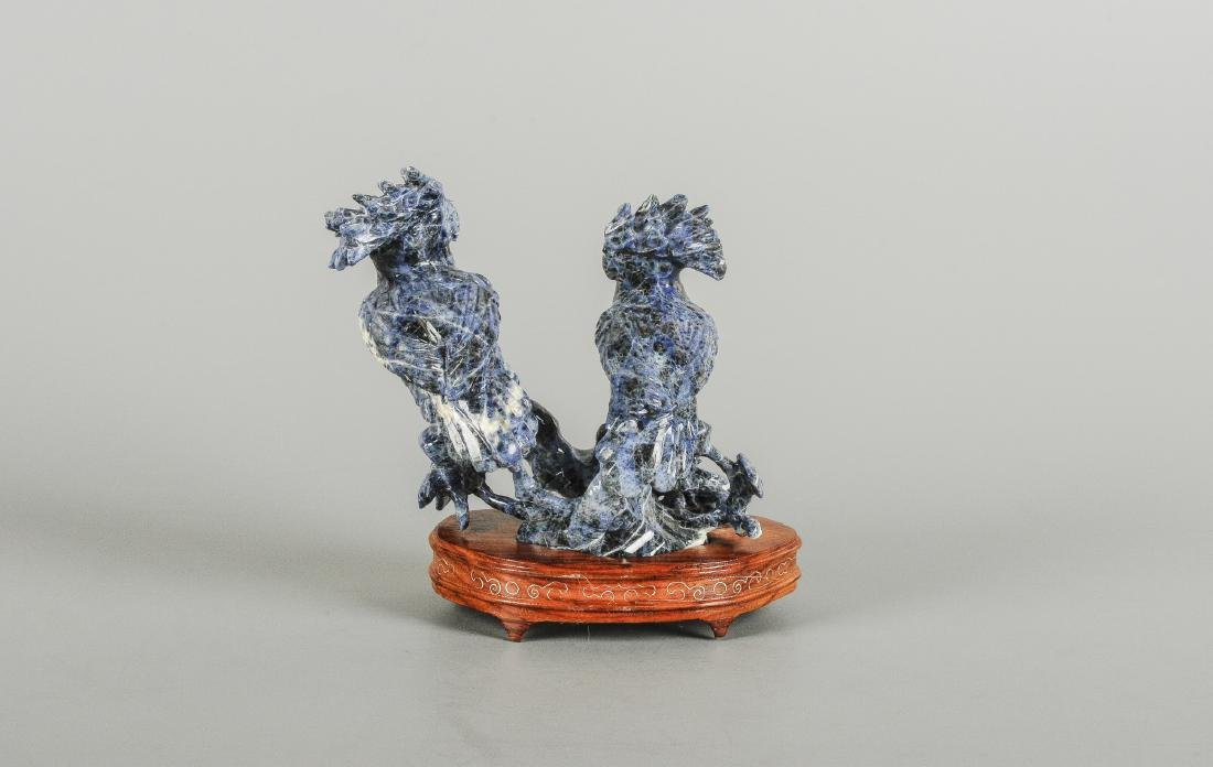 A carved Lapis Lazuli sculpture depicting two parrots.