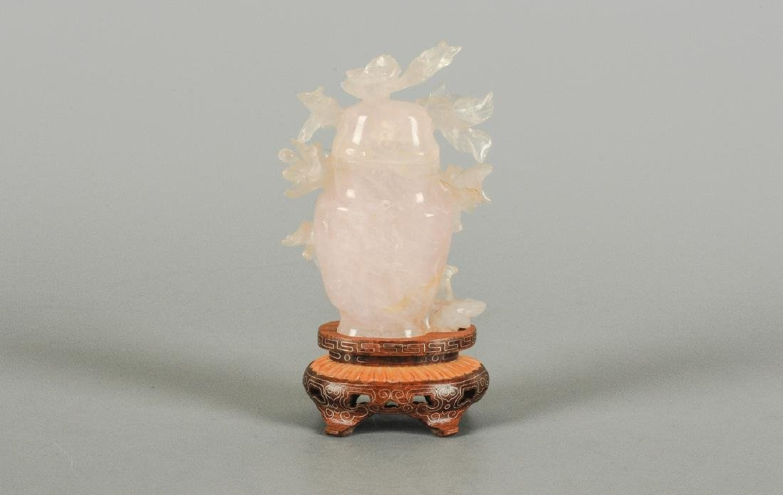 A rose quarts carved vase with lid with floral decor. - 5
