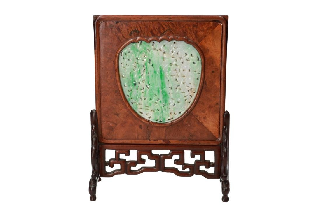 A carved green and white jade plaque, decorated with a - 4
