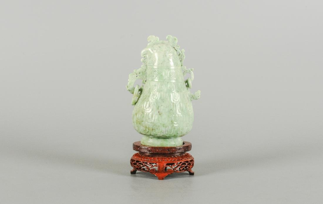 A carved jade miniature vase with lid in the shape of a - 3