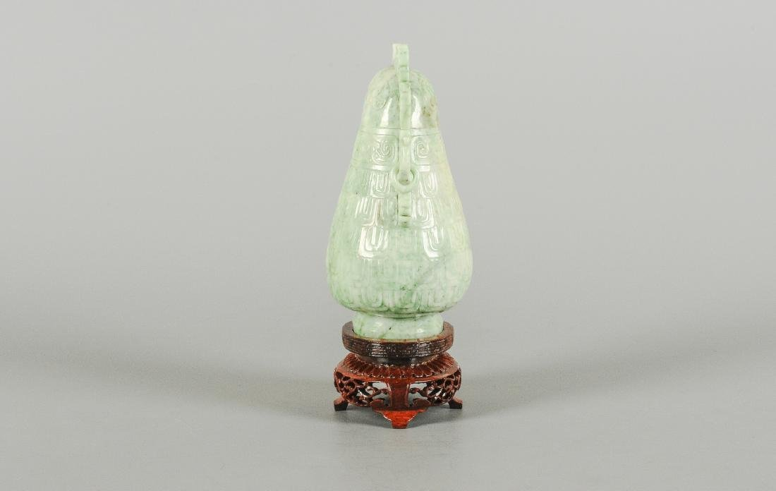 A carved jade miniature vase with lid in the shape of a - 4