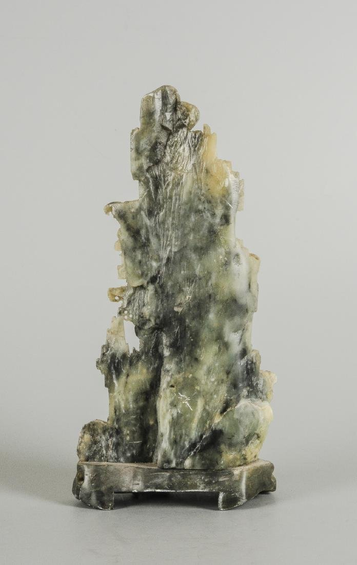 A carved stone sculpture of a mountainous landscape. - 4