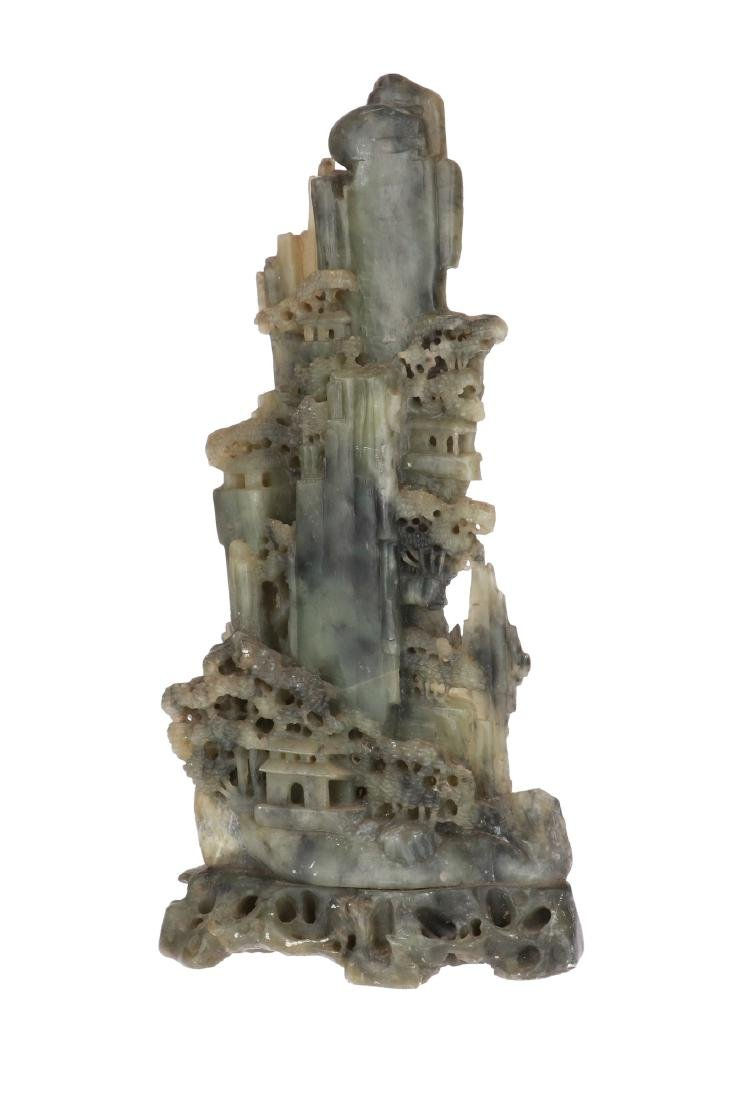 A carved stone sculpture of a mountainous landscape. - 5