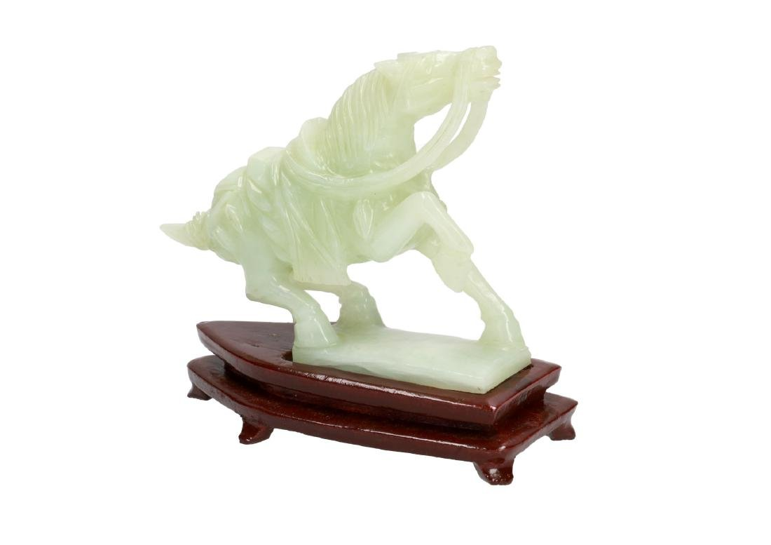 A carved jade sculpture depicting a horse. Unmarked.