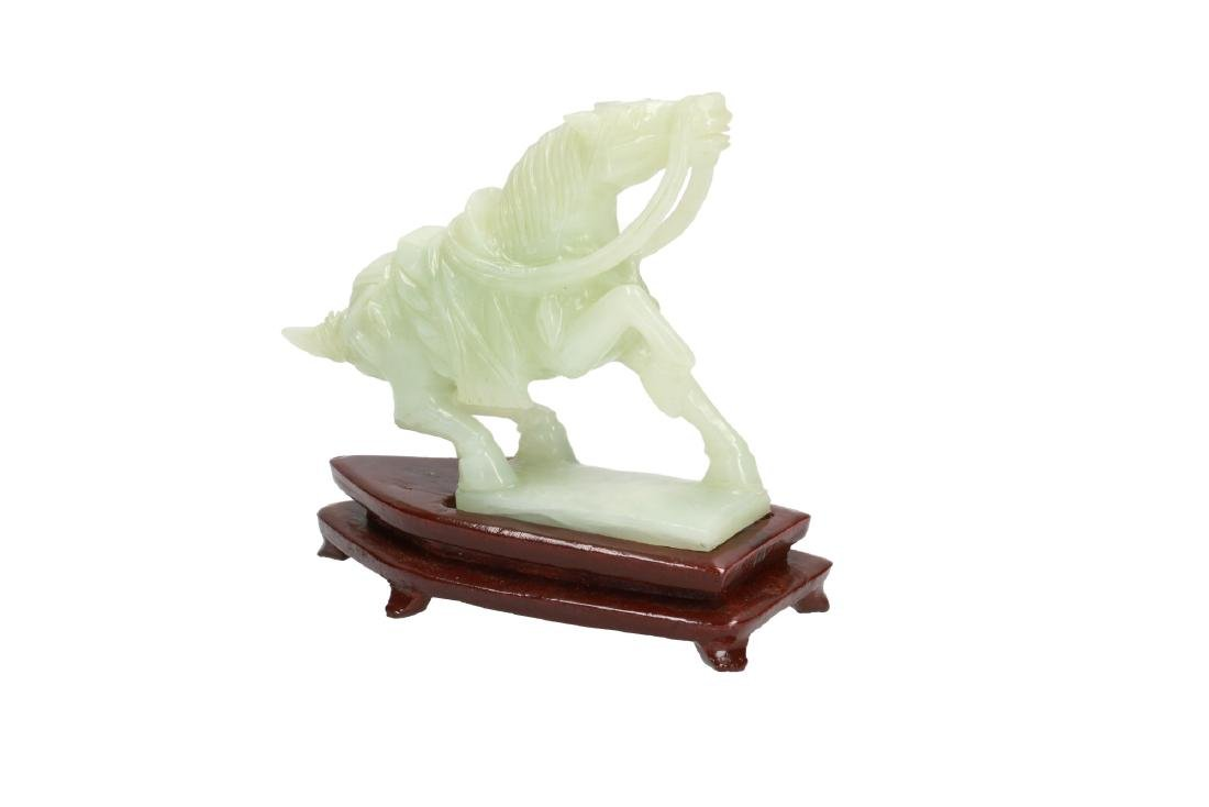 A carved jade sculpture depicting a horse. Unmarked. - 2