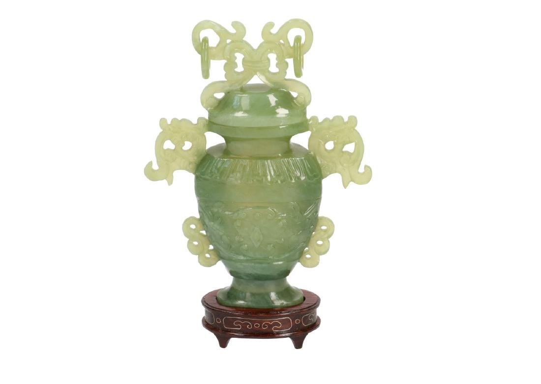 A carved jade miniature vase. Unmarked. China, Tianjin,