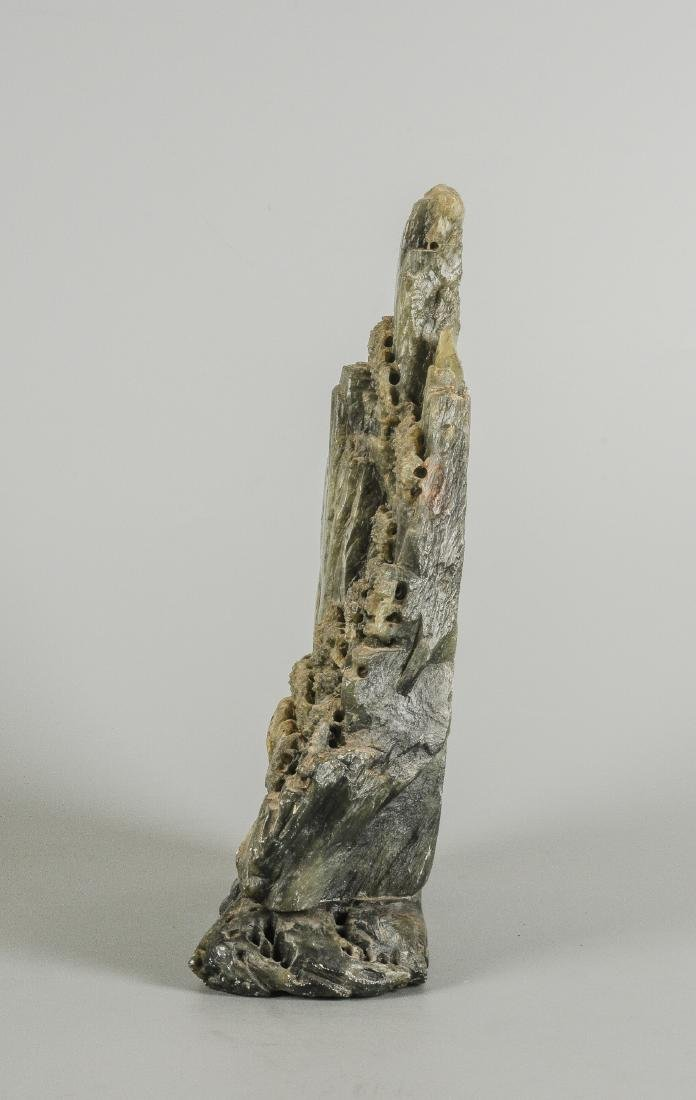 A carved stone sculpture of a mountainous landscape on - 2