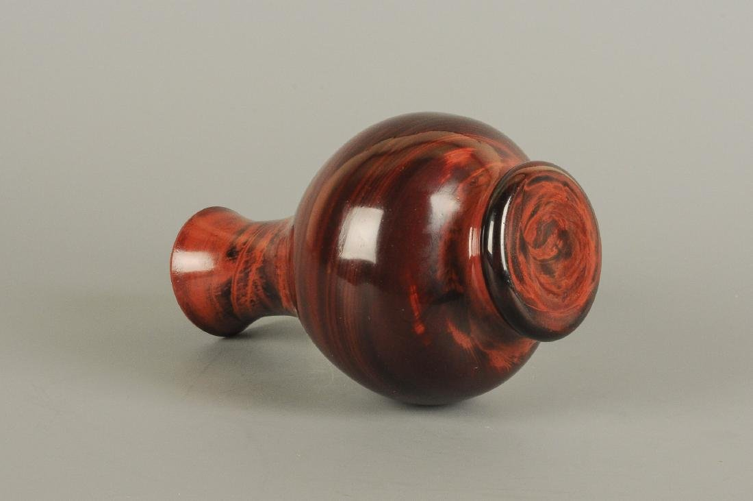 A red marble toned Peking-glass vase. Unmarked. China, - 2