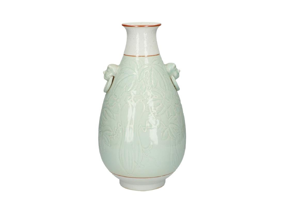 A celadon porcelain vase decorated with cucumbers.