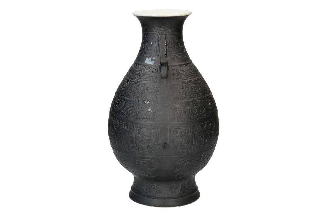A black porcelain vase, decorated with geometrical - 3