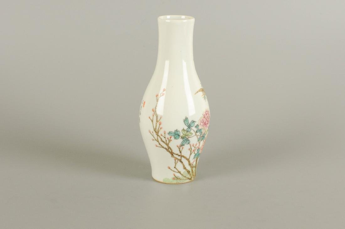 A polychrome porcelain vase decorated with flowers,