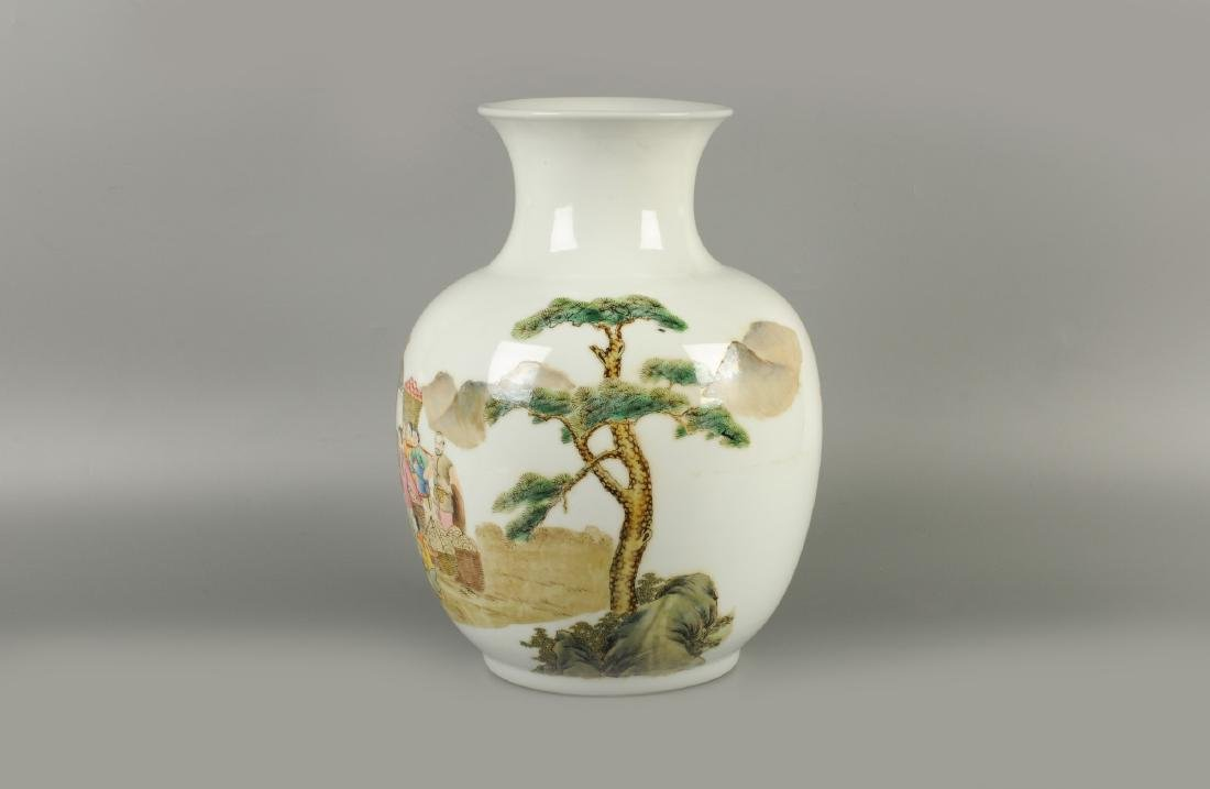 A polychrome porcelain vase, decorated with merchants