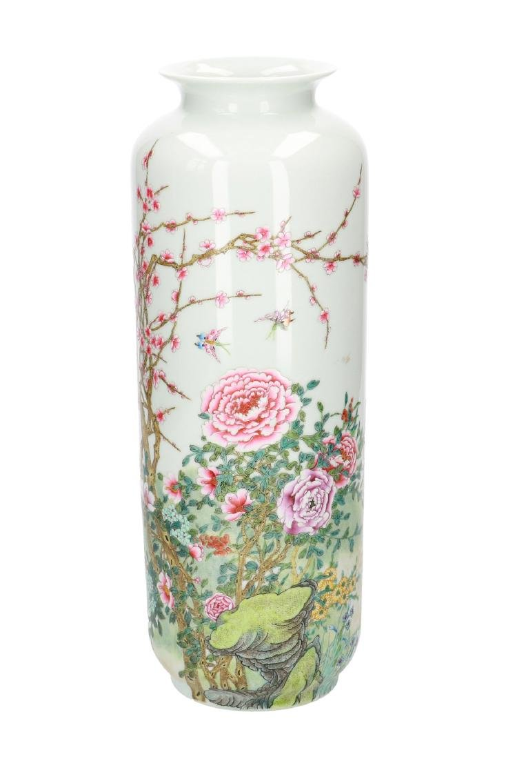 A polychrome porcelain vase with floral decor, dated