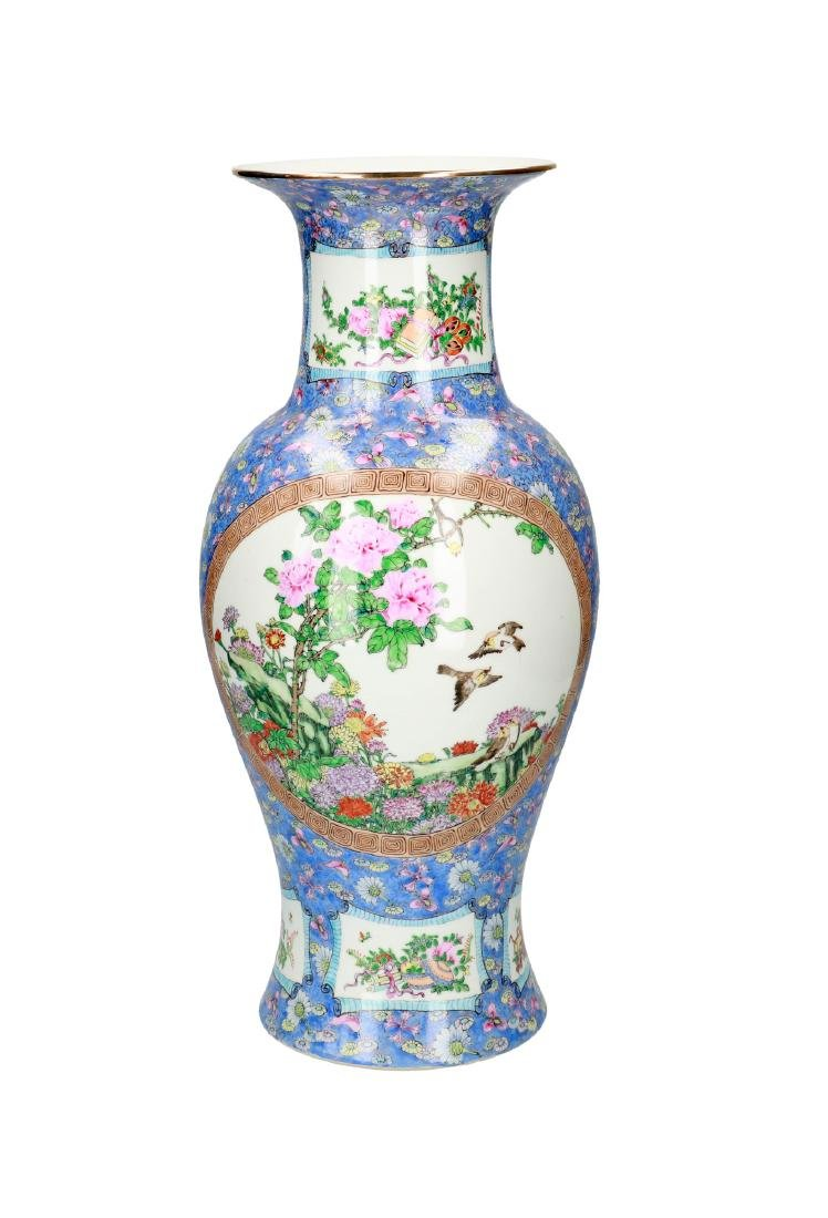 A polychrome porcelain vase, decorated with flowers and