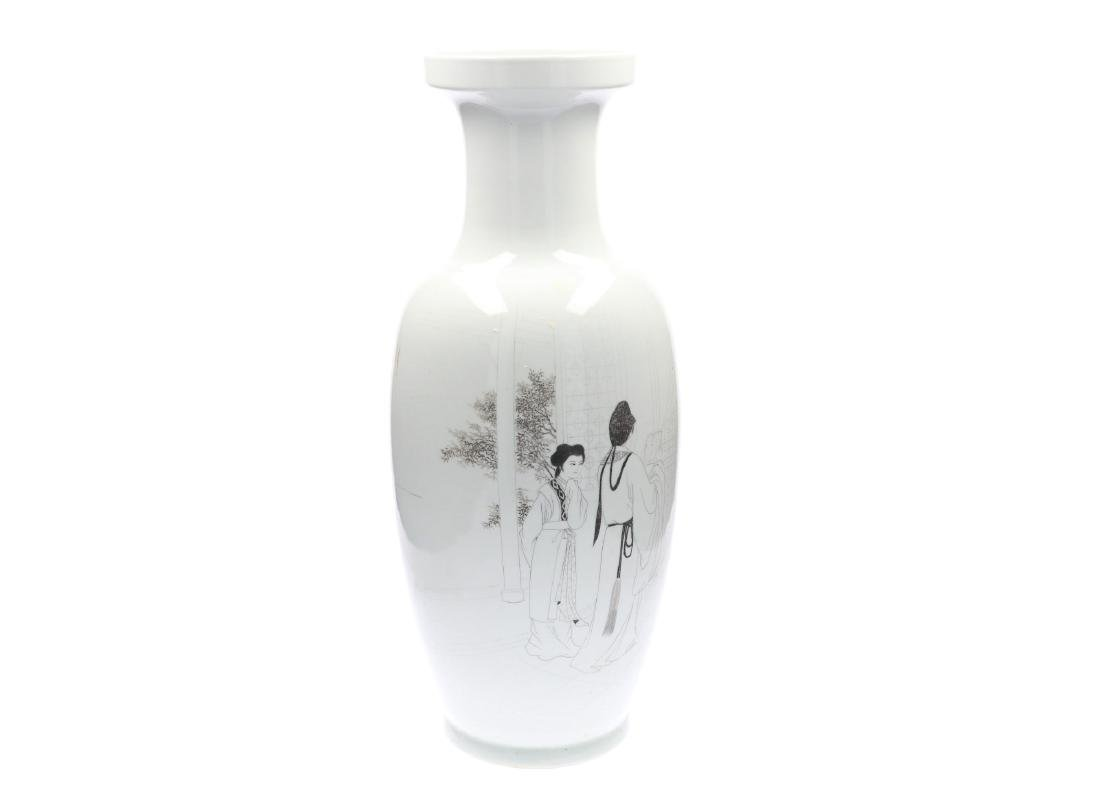 A black and white porcelain vase, decorated with