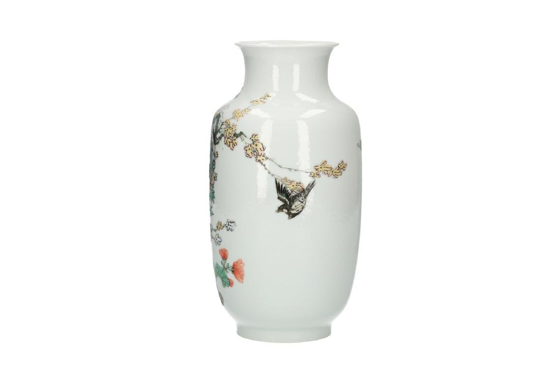 A polychrome porcelain vase decorated with flowers and