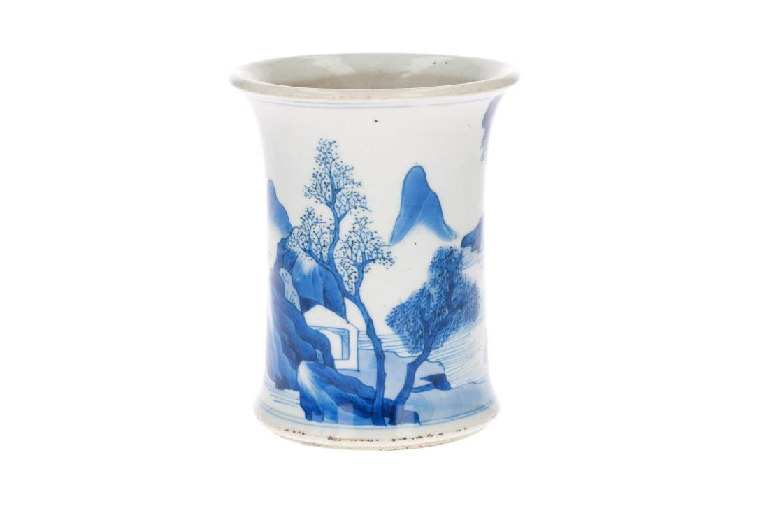 A blue and white porcelain brushpot, decorated with a
