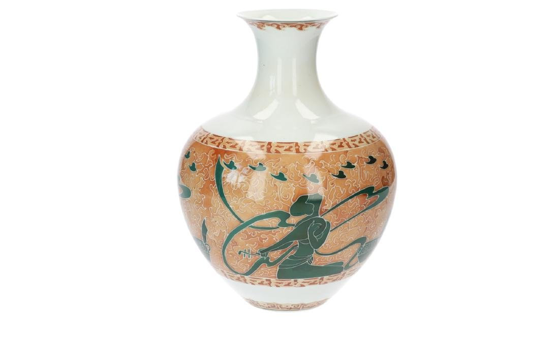A polychrome porcelain vase decorated with kneeling