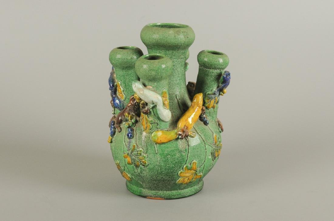 A green glazed five-tube tulip vase, decorated with - 5