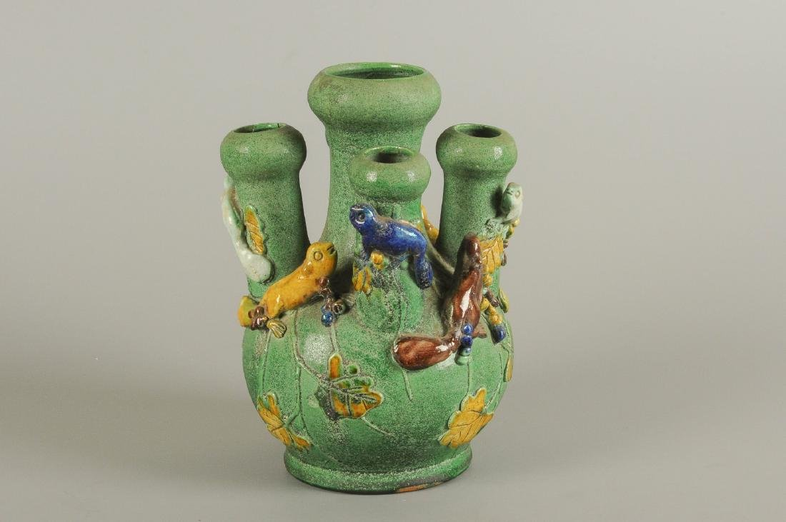 A green glazed five-tube tulip vase, decorated with - 6
