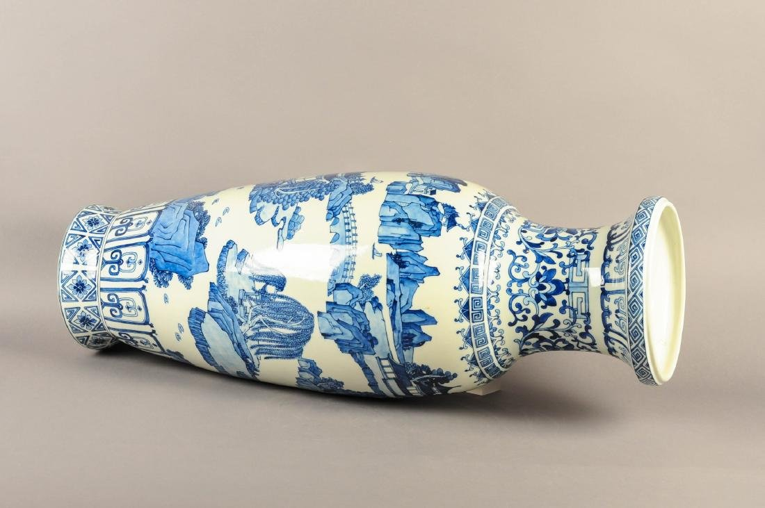 A large blue and white porcelain vase, decorated with a