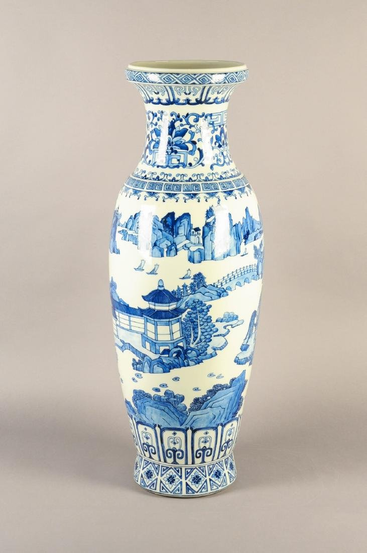A large blue and white porcelain vase, decorated with a - 6