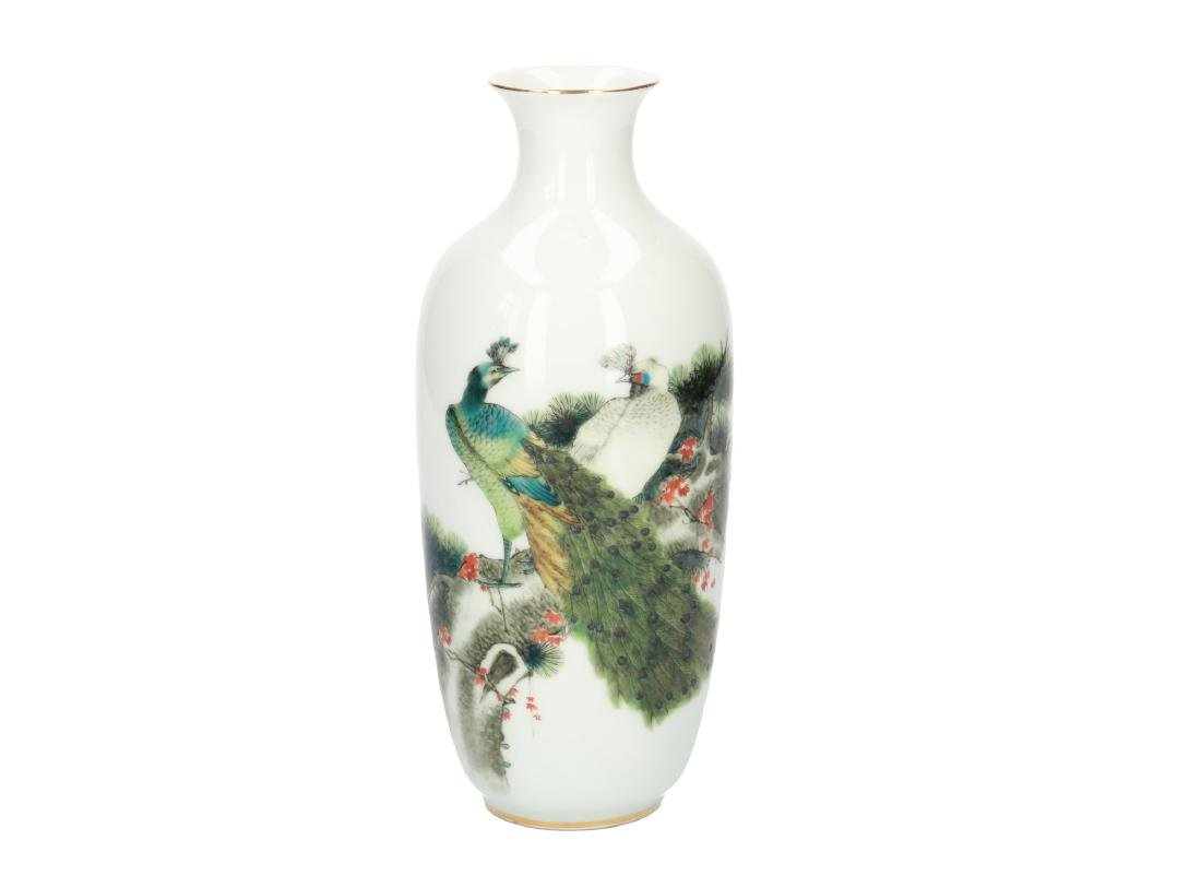 A polychrome porcelain vase decorated with peacocks.